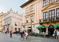 People walking around old city with gothic buildings Royalty Free Stock Photo
