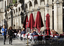 People walking around the royal square of barceelona Royalty Free Stock Images