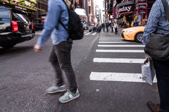 People walking around Times Square buildings in New York City, twillight Stock Photo
