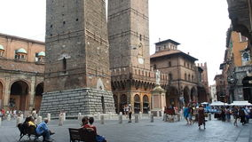 People walking Asinelli tower Bologna stock video footage