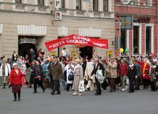 People walking with banners, flags and baloons Stock Images