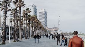 People walking on Barceloneta Beach stock image
