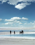 People walking at the beach Royalty Free Stock Image