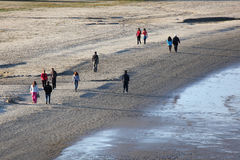 People walking on the beach Royalty Free Stock Photo