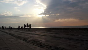 People walking on the beach, clouds,light, colors,Izmir city,turkey stock footage