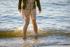 People walking on the beach in the ocean. Royalty Free Stock Photography