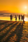 People walking on the beach. At sunset stock image