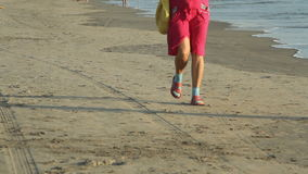 People walking on the beach. Unidentified people walking on the beach stock video footage
