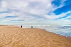 People Walking on the Beach in Valencia Stock Images