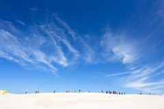 People walking in the big dune, Slowinski National Park, Poland Stock Photos
