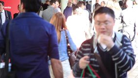 People walking, blurred background stock footage