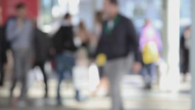 People walking, blurred background stock video