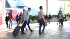 People walking, blurred background stock video footage