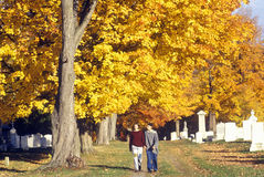 People walking in Brattleboro Cemetery in autumn, VT Stock Photos