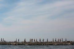 People walking on breakwater near Lake Micigan Stock Photo