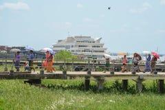 People walking on bridge at Botahtaung Jetty port Royalty Free Stock Photos