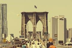 People Walking in Bridge. People walking in the Brooklyn Bridge in the morning Royalty Free Stock Images
