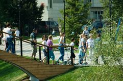 People walking on a bridge in Butovo park, Moscow, Russia stock photography