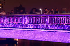 People walking on the bridge by the Love River of Kaohsiung during the celebrations for the Chinese new year. Royalty Free Stock Photo