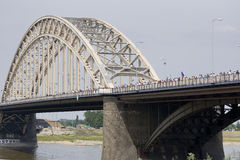 People walking on the bridge of Nijmegen Stock Photo