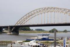 People walking on the bridge of Nijmegen Stock Image