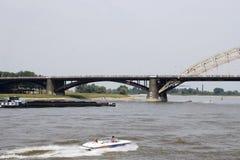 People walking on the bridge of Nijmegen Stock Photo