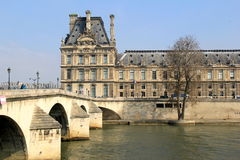 People walking on bridge over The Seine, leading to The Louvre, Paris,France,2016 Stock Photography