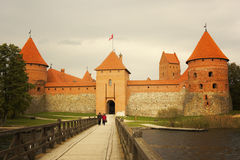 People walking on bridge to Trakai Island Castle Royalty Free Stock Photos