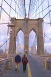 People walking on Brooklyn Bridge. Brooklyn Bridge in winter stock photography