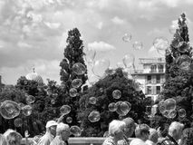 People walking with bubbles floating above their heads. Berlin, Mitte.