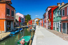 People are walking in Burano. BURANO, VENICE, ITALY - JULY 16: People are walking in Burano on July 16, 2012 in Venice. Burano is an island in the Venetian Royalty Free Stock Photos