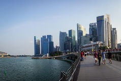 People walking at business district in Singapore Stock Photos