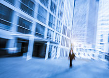 People walking in the business district, with skyscrapers. Stock Images