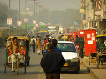 People walking on busy street of Delhi, India Stock Image