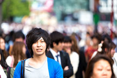 People walking at a busy street in Tokyo, Japan Stock Image