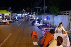 People walking and buying things at walking street night market Stock Images