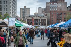 People walking and buying Union Square Greenmarket Farmers Market in NYC royalty free stock photo