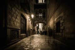 People walking at Carrer del Bisbe  in Barri Gotic Royalty Free Stock Photography