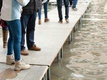 People walking on catwalk in Venice Stock Photo
