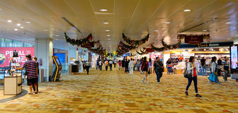 People walking at the Changi Airport in Singapore Stock Photography