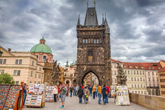 People walking on the Charles Bridge in Prague Stock Photos