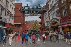 People walking on China town on the Gerrard  Street. Gerrard  Street, London-September 6,2017: People walking on China town on the Gerrard  Street on September 6 Royalty Free Stock Image