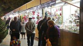 People walking at Christmas market. BARCELONA, SPAIN - NOVEMBER 30, 2015: People walking at Christmas market in evening. Barcelona, Catalonia. Kiosks with
