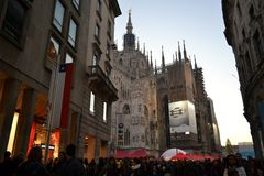 People walking for Christmas shopping and view to Duomo. Royalty Free Stock Image
