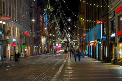 People walking in city center decorated for Christmas Stock Photo
