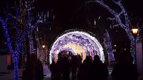 People walking in city center decorated for Christmas stock video footage