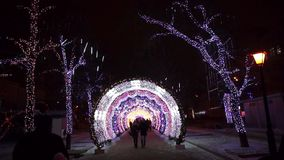 People walking in city center decorated for Christmas stock footage