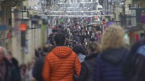People walking in city center, going shopping before holidays, busy lifestyle. Stock footage stock video