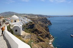 People walking through city Fira Santorini, Greece with its ty Royalty Free Stock Image