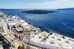 People walking through city Fira Santorini, Greece with its ty Stock Images